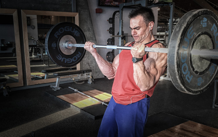 man strength training bicep curl